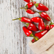 Red peppers in sack — Stockfoto