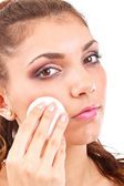 Woman is cleaning face — Stock Photo