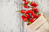 Red peppers in sack — Stock Photo