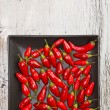 Red peppers on plate — Stock Photo