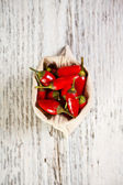 Red peppers in bag — Stock Photo