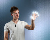 Young man with interface — Stock Photo
