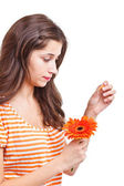 Woman tearing petals — Stock Photo