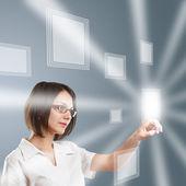 Woman working on modern technology — Stock Photo