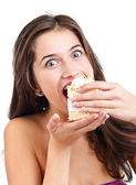 Young woman eating the cake — Stock Photo