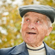 Elderly man in hat - Stock Photo