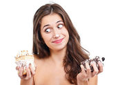 Girl with two cakes — Stock Photo