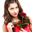 Woman with red rose — Stock Photo