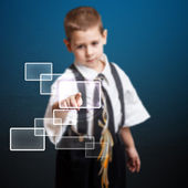 Little boy pressing high tech type — Stock Photo