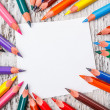 Stock Photo: Multicolored pencils and paper