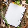 Open notebook with herbs - Stock Photo