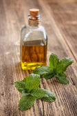 Bottle with mint oil — Stock Photo