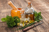 Olive oil and herbs — Stock Photo
