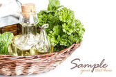 Herbs and oil — Stock Photo