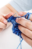 Hands knitting — Stock Photo