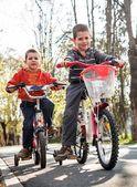 Boys with bike — Stock Photo