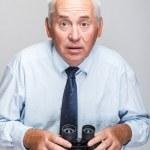 Shocked man with binoculars — Stock Photo
