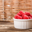 Bowl of raspberries — Stock Photo
