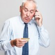 Elderly businessman — Stock Photo