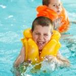 Boys in life jacket — Stock Photo #29526297