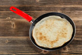 Frying pan with pancake — Stock Photo