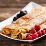 Roll pancakes — Stock Photo #30496139