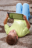 Child holding digital tablet — Stock Photo