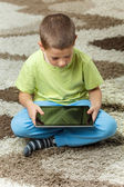 Boy using a tablet — Stock Photo