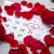 Stock Photo: Red roses lay on calendar