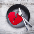 Plate with broken heart — Stock Photo