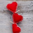 Red hearts hanging — Stock Photo #39385769