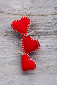Red hearts hanging — Stock Photo