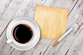Cup of coffee with cigarette  — Stock Photo