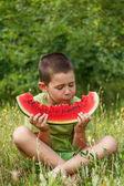 Boy eating watermelon — Stock Photo