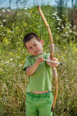 Boy shoots a bow — Stock Photo