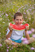 Boy with watermelon — Stock Photo