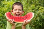 Kid eating watermelon — Stock Photo