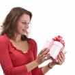 Girl holding a gift — Stock Photo #5127125