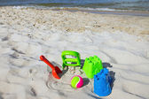 Some toys at the beach — Stock Photo