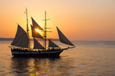 Sailing ship at sunset — Stock Photo
