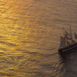 Ship sailing at sunset — Stock Photo