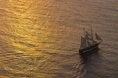Ship sailing at sunset — Stock Photo