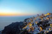 Oia village on santorini island at dawn — Stock Photo