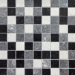 Black, white and gray mosaic tiles — Stock Photo
