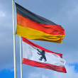 The German and the Berlin flag - Lizenzfreies Foto