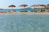 Beach with sunshades — Stock Photo