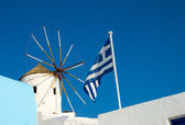 Windmill and flag — Stock Photo