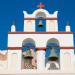 Small belltower of a church in Oia - Stock Photo