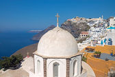 Church in Fira with Imerovigli in the back — Stock Photo