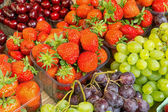 Strawberries, cherries and grapes — Stock Photo